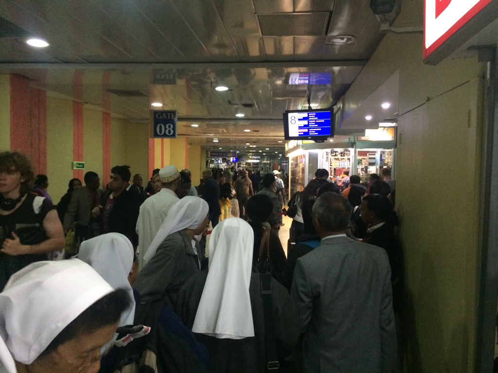 Diverse crowd at the crowded Nairobi international terminal.